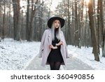 stylish young girl walking in a ... | Shutterstock . vector #360490856