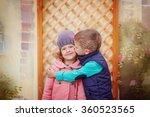Little Boy Kissing Smiling...