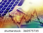Trading Markets. Forex Currency Trading Concept with Computer, Cash Euro Money and Some Line Graph Statistics. - stock photo