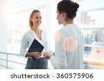 smiling businesswoman holding...   Shutterstock . vector #360575906
