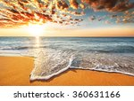 Stock photo brilliant ocean beach sunrise 360631166