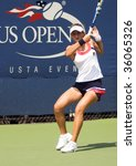 Small photo of QUEENS, N.Y. -AUGUST 25: Irina Begu of Roumania hitting a forehand stroke at the US Open Tennis tournament qualifying rounds at the National Tennis Center in Queens, N.Y. on August 25, 2009.