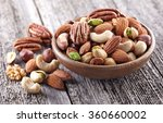 nuts mix on a wooden background | Shutterstock . vector #360660002