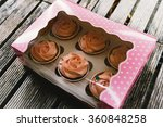 cupcakes with pink frosting in... | Shutterstock . vector #360848258