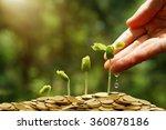 hands watering young baby... | Shutterstock . vector #360878186