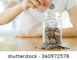 Woman Hands With Coins In Glas...