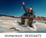 Fisherman On A Lake At Winter...