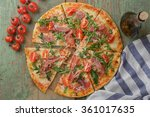 top view of pizza on rustic... | Shutterstock . vector #361017635