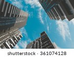skyscrapers view and cloudy sky | Shutterstock . vector #361074128