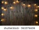 light bulbs on dark wooden... | Shutterstock . vector #361076636