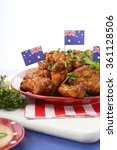 Small photo of Happy Australia Day barbeque setting with spicy chicken wings with red, white and blue color theme.