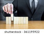 businessman choosing the wood... | Shutterstock . vector #361195922