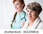 Senior Female Patient And...