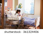 mother with new born baby in... | Shutterstock . vector #361324406