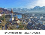 Small photo of Panorama of Thun Church and City with Thunersee and Alps. Thun is a city in the canton of Bern in Switzerland, where the Aare river flows out of Lake Thun. There is a view of Bernese Alps.