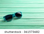 Sunglasses On A Mint Wooden...