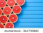 Fresh Grapefruits On Wooden...