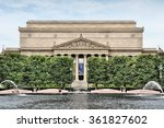 Small photo of WASHINGTON, USA - JUNE 13, 2013: People rest in front of the Archives of the United States in Washington DC. National Archives and Records Administration was formed in 1934.
