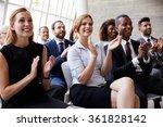 Audience Applauding Speaker At...