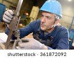 metal worker using machine in... | Shutterstock . vector #361872092