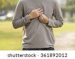 Small photo of Man suffering from acid reflux at park