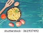 raw pasta  tomatoes egg on dark ...   Shutterstock . vector #361937492