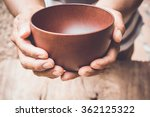 a hungry man holding an empty... | Shutterstock . vector #362125322