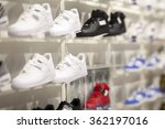 Small photo of shelves with shoes in a sporting goods store