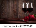 two glasses of red wine and red ...