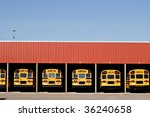 Buses In A Garage