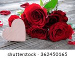 Red Roses And Heart On Wooden...