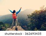 cheering young woman hiker open ... | Shutterstock . vector #362693435