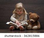 little girl reading a large... | Shutterstock . vector #362815886