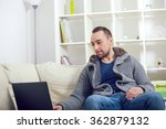 handsome man sitting on sofa... | Shutterstock . vector #362879132