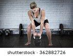 serious muscular woman lifting... | Shutterstock . vector #362882726