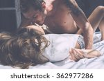 Stock photo young beautiful couple kissing tanned woman and a man with a tattoo 362977286