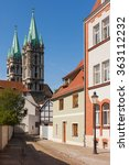 Small photo of Cathedral and sunny alleyway, Naumburg (Saale), Germany