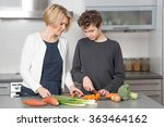 mother and son in the kitchen....