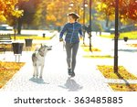 Stock photo happy young woman jogging with her dog in park 363485885