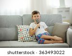 little boy with microphone on a ... | Shutterstock . vector #363493022