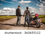 Biker Man And Girl Stands On...