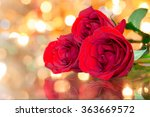 Closeup Of Red Roses Against A...