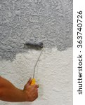 Small photo of Applying plaster on the wall using a trowel