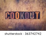 "the word ""cookout"" written in... 