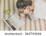 woman using laptop in bed | Shutterstock . vector #363743606