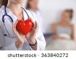 young woman doctor holding a... | Shutterstock . vector #363840272