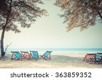 Stock photo beach summer on island vacation holiday relax in the sun on their deck chairs under a giant tree 363859352