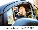 woman driving a car | Shutterstock . vector #363931406