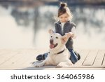 Happy Little Girl With Her Dog...