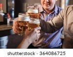 happy friends drinking beer at... | Shutterstock . vector #364086725